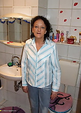 Mature Slut Caught Changing Clothes In The Bathroom